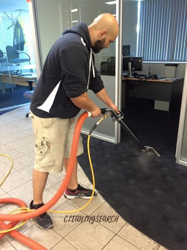 Carpet Cleaner doing job in office